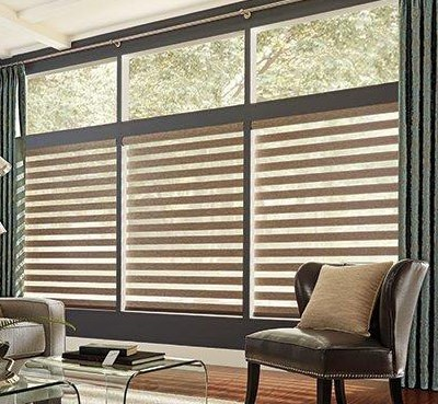 Natural colour tone window coverings in bright modern living room
