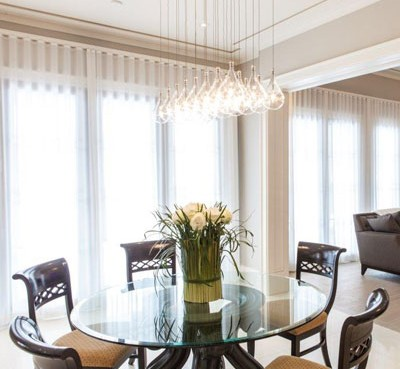Elegant modern dining room with white blinds and flowers decoration