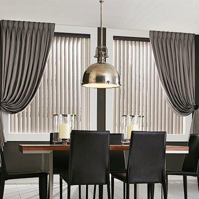 Elegant modern dining room with grey tone curtains and shades