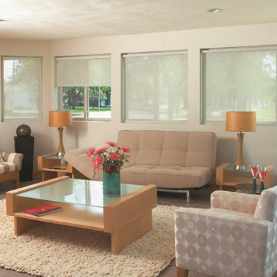 bright modern living room with light orange furniture and shades